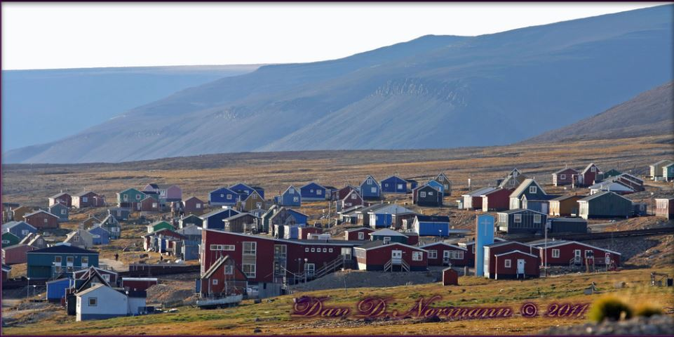 Qaanaaq Greenland The northernmost village in Greenland 78 degrees north deep in the Arctic meltwater flows in small rivulets and larger streams to the Inglefield Bredning in Danish.